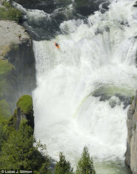 Kayakers going over waterfalls