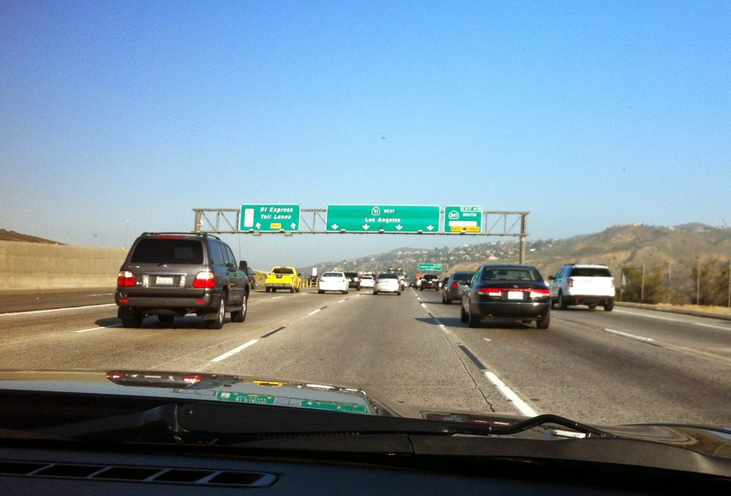A sign shows the lanes that will take us to Los Angeles.
