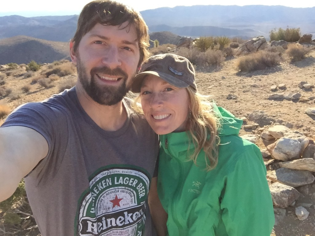 A selfie of Jeff and Andrea on top of a mountain in Joshua Tree National Park