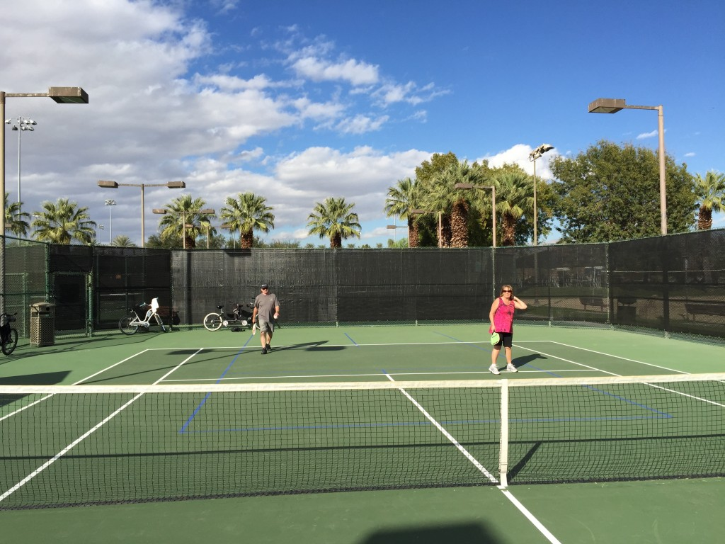 Playing pickleball on a tennis court in Palm Springs, California.