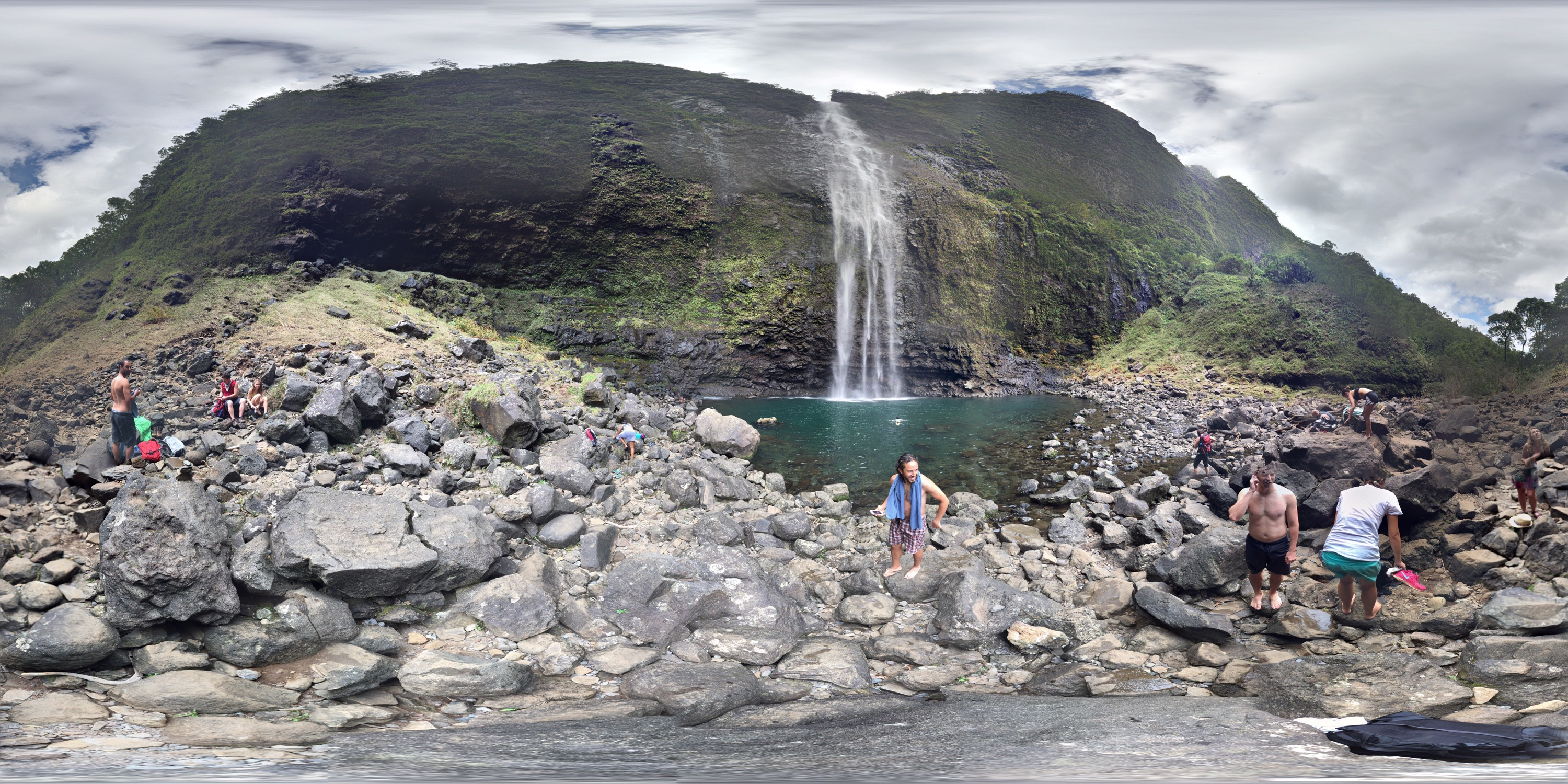 A 360 degree panarama showing the falls, people in bathing suits, and lots of rocks.