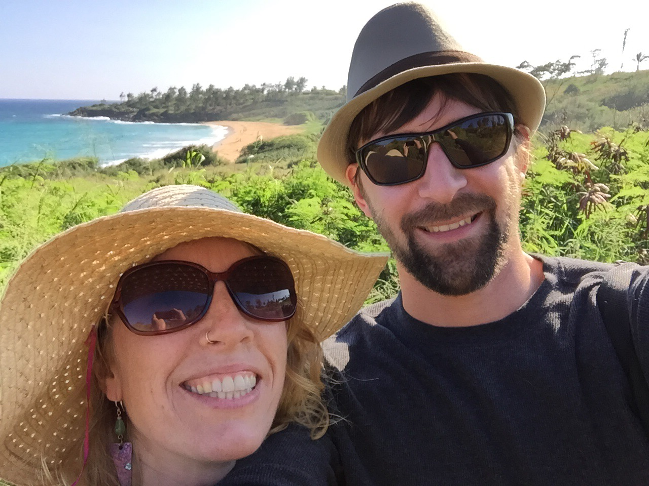 Selfie of Andrea and Jeff in front of a beach