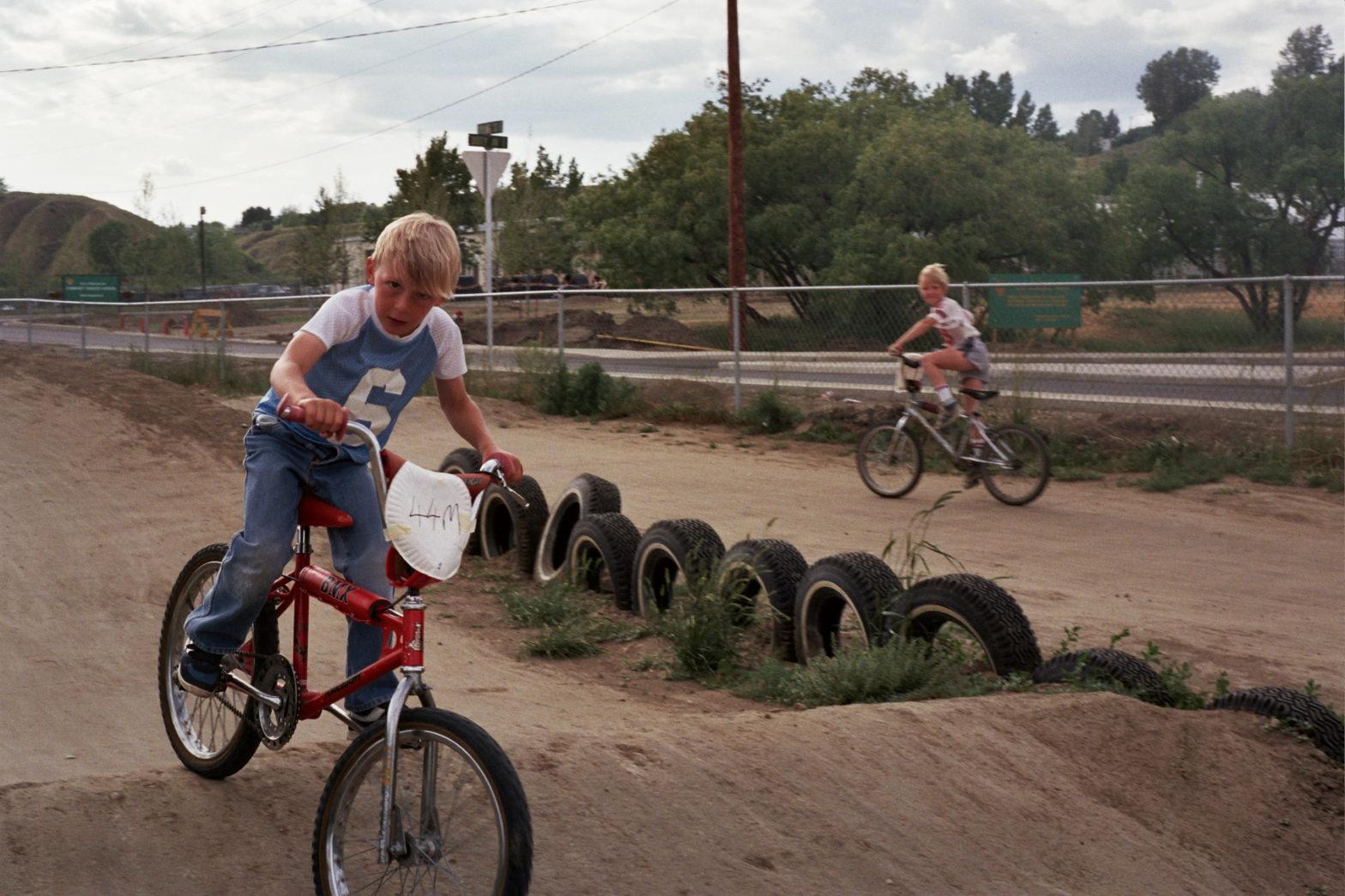 Jeff Milner riding BMX, Chris MacDonald in the background
