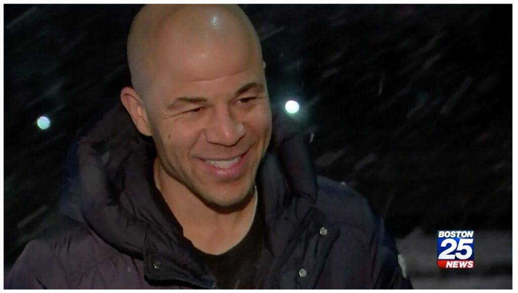 Jerome Iginla talking to news reporter about the weather.